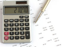 Calculator pen and finances Stock Photography
