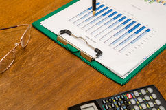 Calculator, pen and financial charts Royalty Free Stock Images