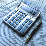 Calculator, and pen with financial document. Calculator,  and pen with financial documents in blue colors Royalty Free Stock Photography