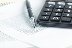 Calculator and pen with financial documents Royalty Free Stock Photo