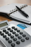 Calculator and pen on financial notebook in the diagram Royalty Free Stock Photos