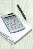 Calculator and Pen On Financial Paper Stock Photo