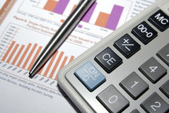 Calculator, pen and financial report. Royalty Free Stock Photography
