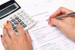 Calculator, pen and finansial report Stock Photo