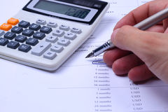 Calculator, pen and finansial report Royalty Free Stock Image