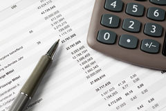 Calculator with pen and form, close up Royalty Free Stock Photo