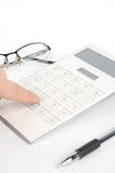 Calculator and pen with glasses Royalty Free Stock Image