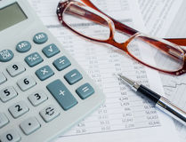 Calculator,pen,glasses and financial documents. Royalty Free Stock Photos