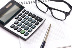 Calculator, pen and glasses isolated Royalty Free Stock Photos