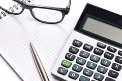 Calculator, pen and glasses isolated Royalty Free Stock Photo