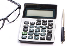 Calculator, pen and glasses isolated Stock Image