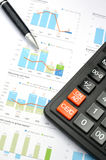Calculator, pen and graph Royalty Free Stock Photography