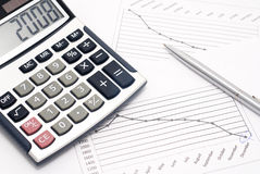 Calculator, pen and graph Stock Photos