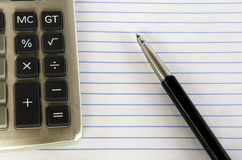 Calculator and pen. Stock Images