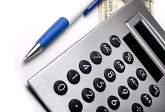 Calculator. With pen isolated on white Royalty Free Stock Photography