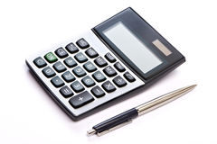 Calculator and pen isolated Royalty Free Stock Image