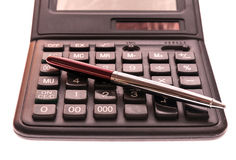 Calculator and pen isolated on white background Stock Image