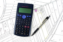 Calculator pen and map Royalty Free Stock Photography