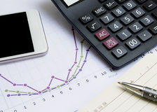 Calculator,pen, mobile phone, notebook and financial chart, busi Stock Images