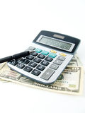 Calculator pen and money Stock Photography