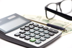 Calculator, pen and money isolated Royalty Free Stock Images