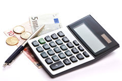 Calculator, pen and money isolated Royalty Free Stock Image