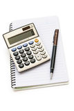 Calculator and pen on note book Stock Photos