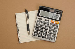 Calculator with pen and note book Royalty Free Stock Photo