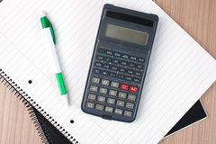 Calculator,pen and notebook Stock Image