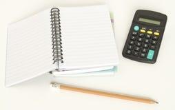 Calculator pen and notebook Stock Photos