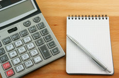 Calculator, pen and notebook Royalty Free Stock Image