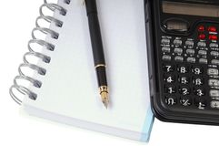Calculator, pen and notebook Stock Image