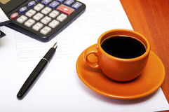 Calculator,pen, notebook and business reports. Coffee Break Royalty Free Stock Photography