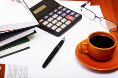 Calculator,pen, notebook and business reports. Coffee Break Stock Photos