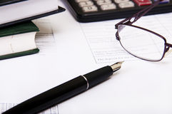 Calculator,pen, notebook and business reports Stock Image