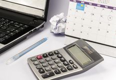 Calculator and pen and notebook Stock Photo