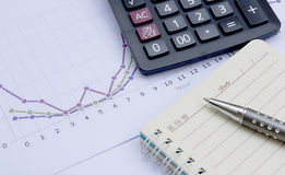 Calculator,pen, notebook and financial chart, business work stat Royalty Free Stock Image