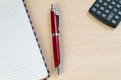 Calculator pen and notebook. On a light background royalty free stock images
