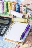 Calculator pen and notebook on the money Royalty Free Stock Photos