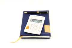 Calculator, pen and notebook. On white background Royalty Free Stock Photography