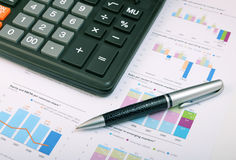 Calculator, pen over annual report Royalty Free Stock Images