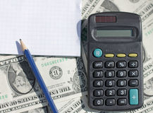 Calculator, pen and pad at dollars Stock Photos