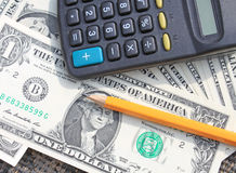 Calculator, pen and pad at dollars Stock Image