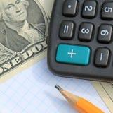 Calculator, pen and pad at dollars stock photos