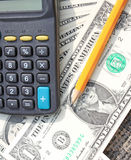 Calculator, pen and pad at dollars Royalty Free Stock Photo