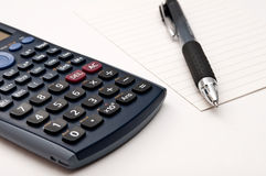 Calculator, pen and paper Royalty Free Stock Photos