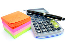 Calculator, pen and paper Royalty Free Stock Image