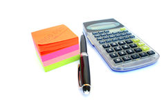 Calculator, pen and paper stock photo