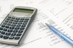 Calculator, pen, and papers ready for auditing Stock Images