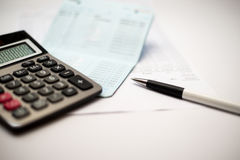 Calculator and pen and  passbook bank. Background Royalty Free Stock Photos